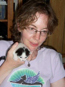 Mama holds one of Rosabelle's kittens