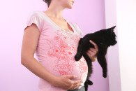 Pregnant woman wit black cat