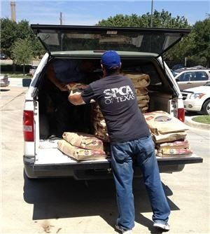 Texas SPCA member unloads food from a truck