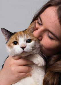 A woman hugging her cat