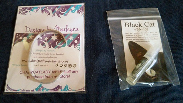 Black cat perfume and Crazy Cat Lady cuff